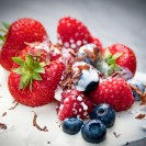 Summer fruits with chocolate shavings and fresh cream